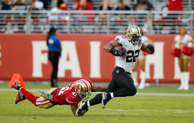 New Orleans Saints' Mark Ingram (22) runs with the ball against the San Francisco 49ers' Antoine Bethea (41) in the second half of their NFL game at Levi's Stadium in Santa Clara, Calif., on Sunday, Nov. 6, 2016. (Josie Lepe/Bay Area News Group)