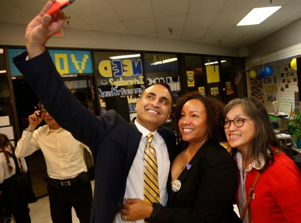 Ash Kalra, left, takes a selfie with his campaign manager, Shay Franco-Clausen, center, and Jane Dobui at an election night gathering in San Jose, Calif., Tuesday, Nov. 8, 2016. Kalra, a current member of the San Jose city council, is making a run for the California Assembly, to represent the 27th Assembly district, facing off against former San Jose city councilwoman and vice-mayor Madison Nguyen. (Patrick Tehan/Bay Area News Group)