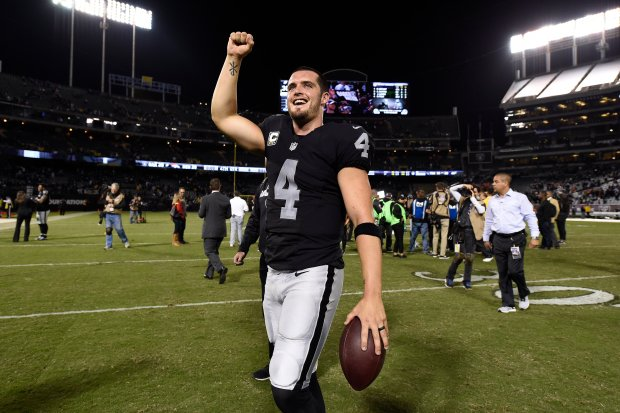 Oakland Raiders quarterback Derek Carr (4) celebrates after defeating the Denver Broncos during their NFL game at the Coliseum in Oakland, Calif., on Sunday, Nov. 6, 2016. The Raiders defeated the Broncos 30-20. (Jose Carlos Fajardo/Bay Area News Group)