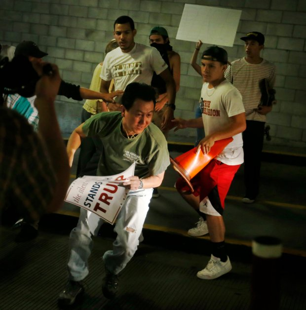 Protesters harass a Trump supporter in the San Jose Convention Center parking garage as Presidential candidate Donald Trump holds a rally in San Jose, Calif., Thursday, June 2, 2016. (Patrick Tehan/Bay Area News Group Archives)
