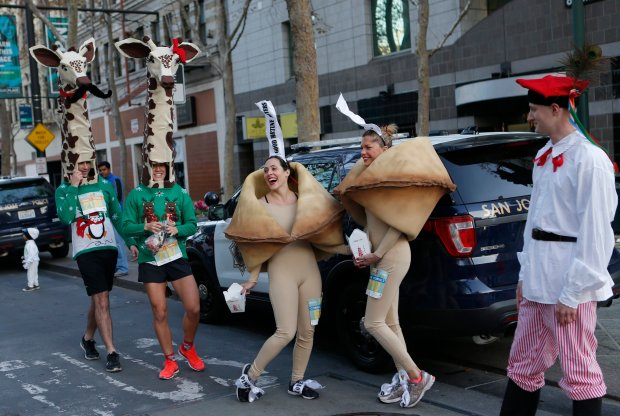 Gillian Cooper, left, Max Katz, Cara Grinels, Liz Howard, Patrick Taffee participate in the customes contest during the 12th Annual Applied Materials Silicon Valley Turkey Trot in downtown San Jose, Calif., on Thursday, Nov. 24, 2016. (Josie Lepe/Bay Area News Group)