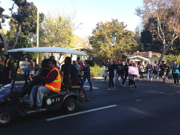 A group of Menlo-Atherton High School students chaperoned by adults in golf carts demonstrated against President-elect Donald Trump on Monday, Nov. 14, 2016. They moved through Atherton, Menlo Park and Palo Alto and back to the school between 1 p.m. and 4 p.m. (Kevin Kelly / Daily News)