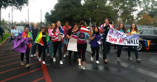 Palo Alto High School students depart the school Tuesday afternoon on a protest march to downtown Palo Alto, where they were expected to be joined by students from other schools for a 2:30 p.m. rally at Lytton Plaza on University Avenue. (Jacqueline Lee / Daily News)