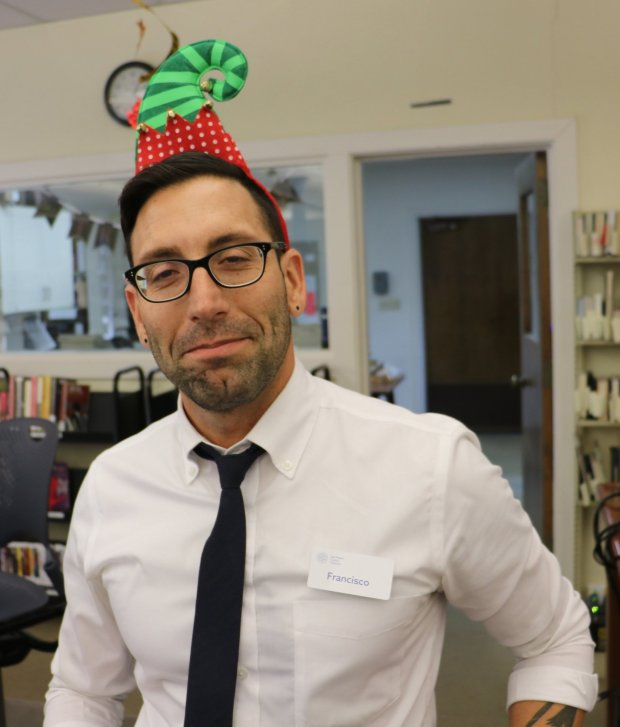 "Francisco Vargas, manager of Atherton Library starts his Christmas celebration early, on Nov. 21, 2016. The holiday must have big meaning for him: The tatoo just barely visible on his left arm is a character from the movie ""The Nightmare Before Christmas."" (John Orr / Daily News)"