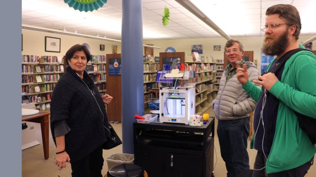 "Atherton Library may be getting on in years, but offers some modern amenities, such as a 3-d printer. Maria Elena Aguilar, Carlos Moad and Gerardo Moad, from left, use the 3-D printer at the library on Monday, Nov. 21, 2016. They are making what designer Carlos Moad described as a Japanese puzzle, which he previously made from wood. ""It's easier with this printer,"" he said. (John Orr / Daily News)"