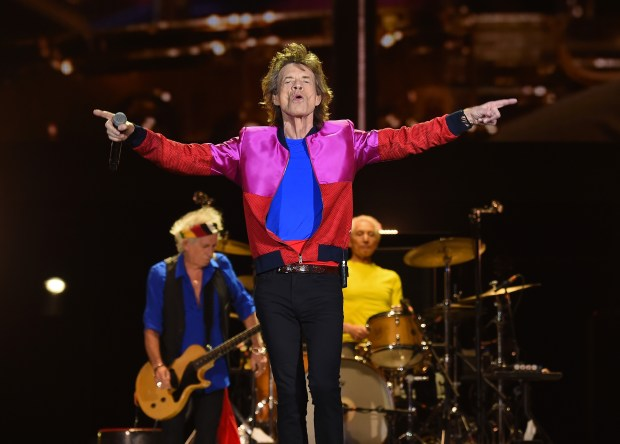 FILE - DECEMBER 08, 2016: Rock legend Mick Jagger and his partner Melanie Hamrick have welcomed a baby boy, Jagger's 8th child. INDIO, CA - OCTOBER 14: (L-R) Musician Keith Richards, singer Mick Jagger and musician Charlie Watts of The Rolling Stones perform during Desert Trip at the Empire Polo Field on October 14, 2016 in Indio, California. (Photo by Kevin Winter/Getty Images)
