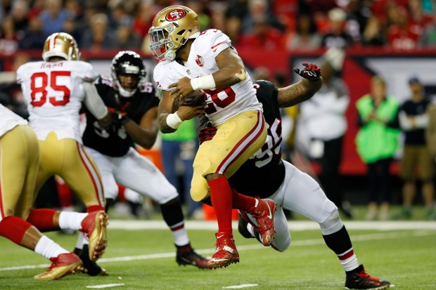 Carlos Hyde #28 of the San Francisco 49ers breaks a tackle by Jonathan Babineaux #95 of the Atlanta Falcons during the second half at the Georgia Dome on December 18, 2016 in Atlanta, Georgia. (Photo by Kevin C.  Cox/Getty Images)