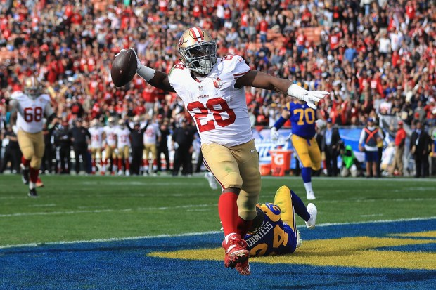 Carlos Hyde #28 of the San Francisco 49ers celebrates scoring a touchdown during the first quarter against the Los Angeles Rams at Los Angeles Memorial Coliseum on December 24, 2016 in Los Angeles, California.  (Photo by Sean M. Haffey/Getty Images)