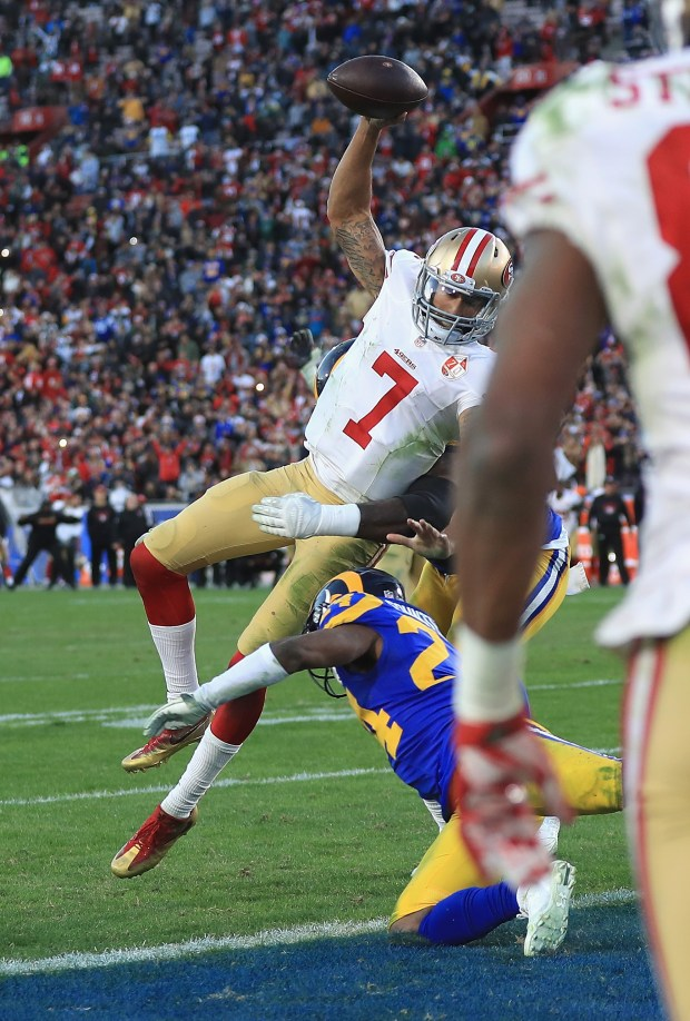 Colin Kaepernick #7 of the San Francisco 49ers jumps into the end zone for a two point conversion during the fourth quarter against the Los Angeles Rams at Los Angeles Memorial Coliseum on December 24, 2016 in Los Angeles, California. (Photo by Sean M. Haffey/Getty Images)