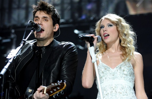 Musician John Mayer and singer Taylor Swift perform together at the 2009 Z100 Jingle Ball at Madison Square Garden in New York on Friday, Dec. 11, 2009. (AP Photo/Evan Agostini)