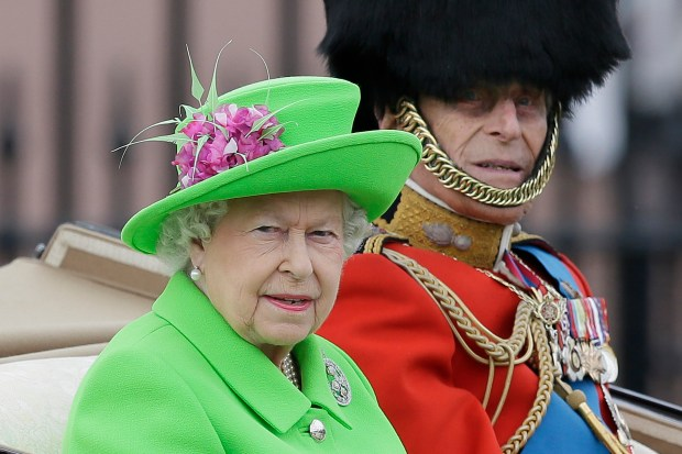 FILE - In this Saturday, June 11, 2016 file photo, Britain's Queen Elizabeth and Prince Philip ride in a carriage during the Trooping The Colour parade at Buckingham Palace, in London. Buckingham Palace officials say Queen Elizabeth II and her husband Prince Philip have delayed their planned Christmas trip because both are suffering from heavy colds. The palace said the pair had been planning to travel by train to the queen's country estate Wednesday, Dec. 21, 2016 but have postponed the trip. (AP Photo/Tim Ireland, file)