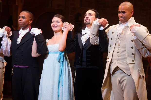 "In this Thursday, Aug. 6, 2015, file photo, Leslie Odom Jr., from left, Phillipa Soo, Lin-Manuel Miranda and Christopher Jackson appear at the curtain call following the opening night performance of ""Hamilton"" at the Richard Rodgers Theatre in New York. Fans of Broadway gave producers reasons to smile this Christmas, with 18 of the current 37 shows breaking the $1 million mark for the week, led by ""Hamilton,"" the new Andrew Lloyd Webber musical ""School of Rock _ The Musical"" and Disney's ""Aladdin"" and ""The Lion King."" (Photo by Charles Sykes/Invision/AP, File)"
