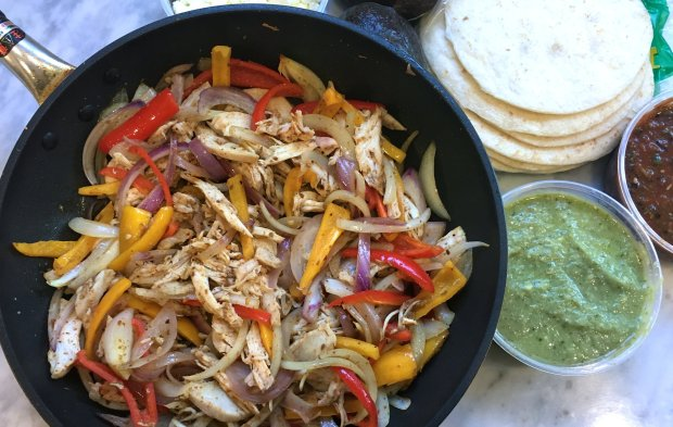 Chicken fajitas take advantage of that supermarket shortcut, the juicyrotisserie chicken, to get dinner on the table in a hurry. (Photo: A Little Yumminess)