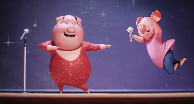 """This image released by Universal Pictures shows Gunter, voiced by Nick Kroll, left, and Rosita, voiced by Reese Witherspoon, in a scene from, """"Sing."""" (Illumination Entertainment/Universal Pictures via AP)"""