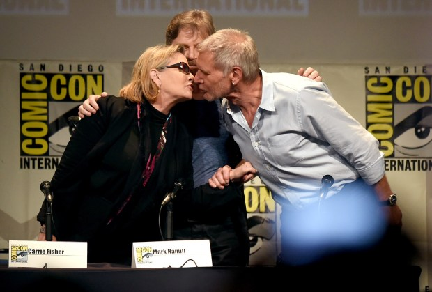 SAN DIEGO, CA - JULY 10: (L-R) Actors Carrie Fisher, Mark Hamill and Harrison Ford pose onstage at the Lucasfilm panel during Comic-Con International 2015 at the San Diego Convention Center on July 10, 2015 in San Diego, California. (Photo by Kevin Winter/Getty Images)
