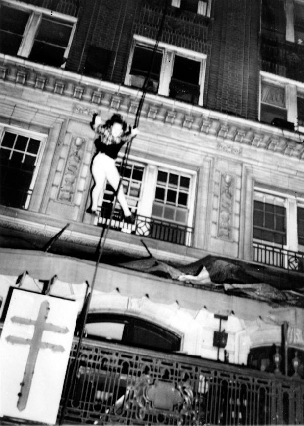 In this Dec. 7, 1946 photo, a woman leaps from an upper story to escape the burning Winecoff Hotel in Atlanta. Seconds later the woman crashed to her death on the hotel marquee. An amateur photographer captured the horror of a woman leaping to escape flames roaring through the Winecoff Hotel in Atlanta in 70 years ago, killing 119 people and leading President Truman to call for new fire safety codes nationwide. (AP Photo/Arnold Hardy)