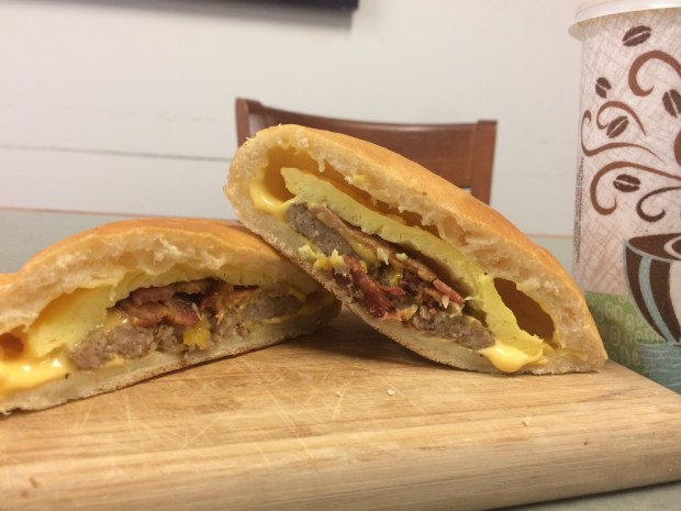 A Breakfast (egg, cheese, sausage and bacon) Zombie is served at Patty's Original Cheese Zombies in Concord. (Daniel M. Jimenez/Staff)