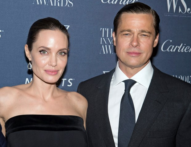 FILE - This Nov. 4, 2015 file photo shows Angelina Jolie Pitt and Brad Pitt at the WSJ Magazine Innovator Awards 2015 at The Museum of Modern Art in New York. The FBI says it will not file charges against Brad Pitt stemming from an alleged dispute with his family aboard a private flight. The FBI released a statement Tuesday, Nov. 22, 2016, saying it has reviewed the circumstances of the alleged incident and will not pursue further investigation. (Photo by Charles Sykes/Invision/AP, File)