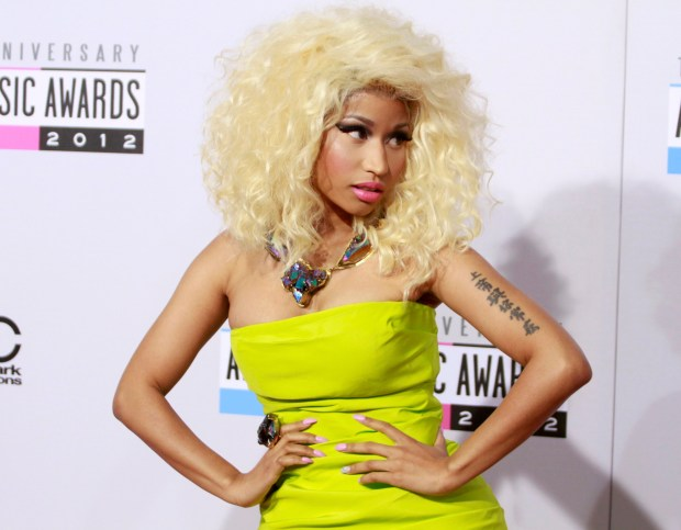 Rapper Nicki Minaj arrives at the 40th American Music Awards in Los Angeles, California November 18, 2012. REUTERS/Jonathan Alcorn (UNITED STATES - Tags: ENTERTAINMENT) (AMA-ARRIVALS)