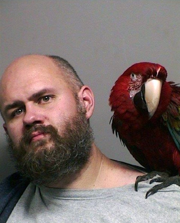 "Booking mug: Craig Buckner with his macaw, named ""Bird."" (Multnomah County Sheriff's Office via AP)"