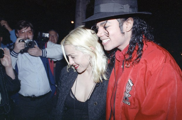 """FILE - In this April 10, 1991, file photo, Madonna and Michael Jackson go out for dinner together at a restaurant in Los Angeles. Madonna told CBS' James Corden in an appearance on """"The Late Late Show,"""" Wednesday, Dec. 7, 2016, that she made out with Jackson once after giving him a glass of win. (AP Photo/Kevork Djansezian, File)"""