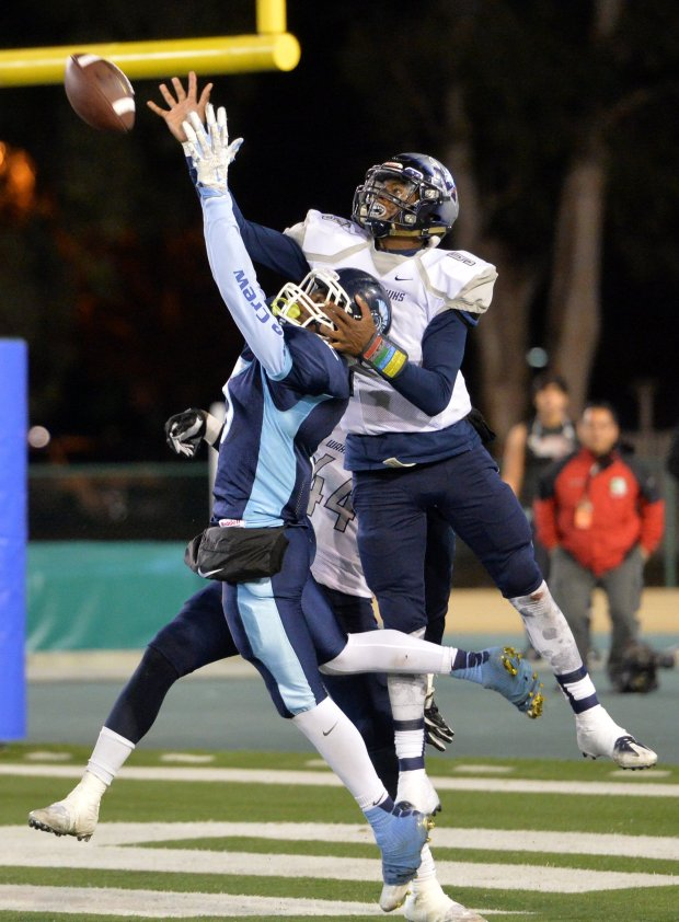 Madison High's Terrell Carter (9) right, knocks a pass away from Valley Christian's D'Angelo Mckenzie (5) on the last play of their California Interscholastic Federation Division 2-AA state championship football game in Sacramento, Calif., on Friday, Dec. 16, 2016. Madison High won the game 21-17. (Doug Duran/Bay Area News Group)
