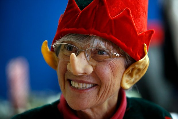 Susan Meyers, one of the founding members of the Congregation of Emeth's annual Christmas Day meal service, plays Santa Claus at St. Joseph's Family Center in Gilroy, Calif., Sunday, Dec. 25, 2016. The Morgan Hill synagogue has made it an annual tradition to relieve church staff so that they may be with their families on Christmas Day. (Karl Mondon/Bay Area News Group)