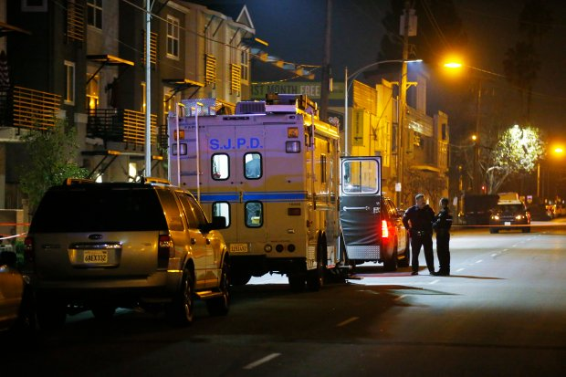 Homicide detectives investigate and gather evidence at the scene of San Jose's 47th homicide on North 10th Street Saturday, Dec. 24, 2016, in San Jose, Calif. A woman was stabbed and she died at the hospital. (Jim Gensheimer/Bay Area News Group)