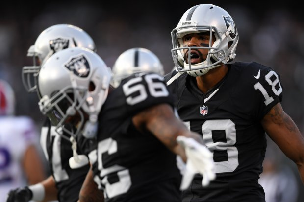 OAKLAND, CA - DECEMBER 04: Andre Holmes #18 of the Oakland Raiders reacts after a catch against the Buffalo Bills during their NFL game at Oakland Alameda Coliseum on December 4, 2016 in Oakland, California. (Photo by Thearon W. Henderson/Getty Images)