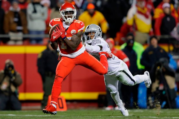 KANSAS CITY, MO - DECEMBER 8: Wide receiver Tyreek Hill #10 of the Kansas City Chiefs catches a pass on his way to a touchdown in front of cornerback David Amerson #29 of the Oakland Raiders at Arrowhead Stadium during the second quarter of the game on December 8, 2016 in Kansas City, Missouri. (Photo by Jamie Squire/Getty Images)