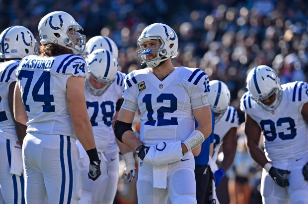 Indianapolis Colts quarterback Andrew Luck (12) stands with his teammates during a timeout while playing the Oakland Raiders in the first quarter of their NFL game at the Coliseum in Oakland, Calif., on Saturday, Dec. 24, 2016. (Jose Carlos Fajardo/Bay Area News Group)