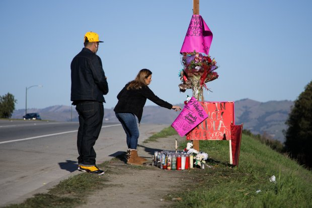 Arlene Duran of San Jose and her younger brother, Sonny Mejia, visit a makeshift memorial for Jessica Marie Zamora, on Dec. 26, 2016 in San Jose. The roadside memorial has sprung up on Capitol Expressway near Snell Avenue, where Zamora and a teenage passenger in another vehicle were killed early on Christmas Day in a head-on crash. (Dai Sugano/Bay Area News Group)