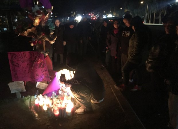 Friends and relatives gather at a shrine for Jessica Zamora, who was killed in an early Christmas morning crash along with a 14-year-old riding in another car. Police believe alcohol was involved in San Jose, Calif., on Monday, Dec. 26, 2016. (Eric Kurhi/Bay Area News Group)