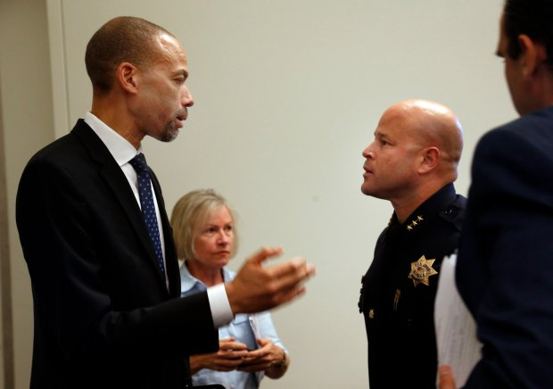 San Jose's new independent police auditor, Walter Katz, left, speaks with assistant police chief Eddie Garcia, after his announcement Tuesday afternoon, Nov. 3, 2015, at City Hall in San Jose, Calif. Katz, the deputy inspector general for Los Angeles County, will be replacing retired judge LaDoris Cordell. (Karl Mondon/Bay Area News Group)