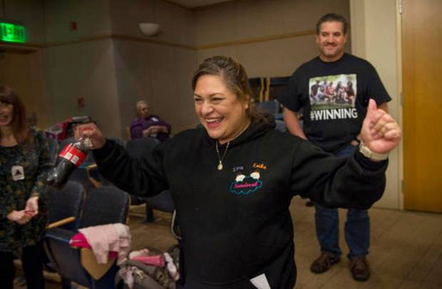 In this photo taken Tuesday, Dec. 6, 2016, Aida and Art Sandoval celebrate after hearing their conjoined twins were separated successfully in Palo Alto, Calif. Conjoined California twins Eva and Erika Sandoval have become two separate toddlers following a 17-hour marathon surgery at the Lucile Packard Children's Hospital Stanford that began on Tuesday, officials said. The 2-year-old Sacramento area girls were born conjoined from the chest down and shared a bladder, liver, parts of their digestive system and a third leg. (The Sacramento Bee via AP Lezlie Sterling)