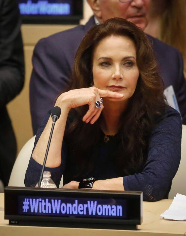 "In this Oct. 21, 2016 file photo, Lynda Carter, who played Wonder Woman on television, listens during a U.N. meeting to designate Wonder Woman as an ""Honorary Ambassador for the Empowerment of Women and Girls,"" at U.N. headquarters. Rhéal LeBlanc, the head of press and external relations, said Tuesday, Dec. 13, the appointment of Wonder Woman as an Honorary Ambassador for the Empowerment of Woman and Girls would end this week, a move that come less than two months after a splashy ceremony at the U.N. (AP Photo/Bebeto Matthews)"