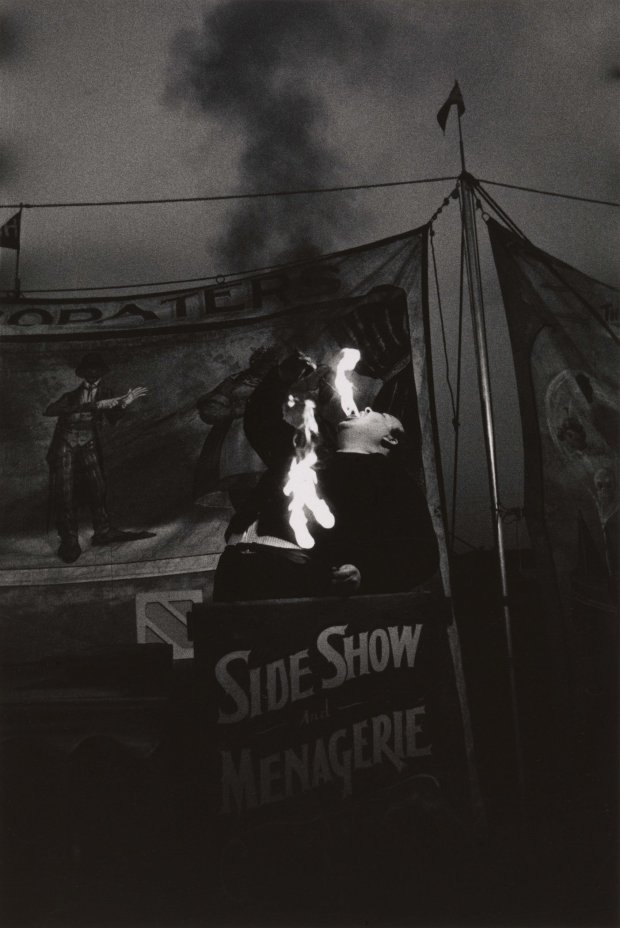 """Diane Arbus, """"Fire Eater at a carnival, Palisades Park, N.J. 1957."""" (© TheEstate of Diane Arbus, LLC, all rights reserved)"""