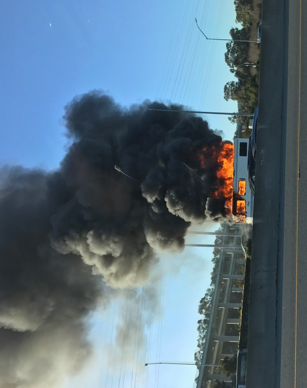 A recreational vehicle burns on southbound Highway 101 near San Francisco International Airport on Friday Jan. 13, 2017 (Neil Chase/Bay Area News Group)