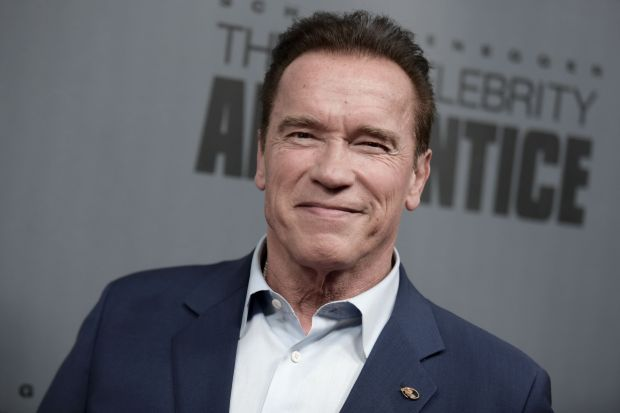 "(FILES) This file photo taken on December 9, 2016 shows Arnold Schwarzenegger as he attends ""The New Celebrity Apprentice"" Q & A and Red Carpet Event At Universal Studio, Universal City, California.When Donald Trump hosted ""The Celebrity Apprentice,"" he dismissed contestants with what became his indelible catchphrase: ""You're fired."" Now that Trump is poised to take over the White House, there is a new boss on the reality show. And Arnold Schwarzenegger isn't just firing people anymore. ""You're Terminated!"" the Hollywood star and former California governor said in Monday night's premiere of the show, now in its eighth season. / AFP PHOTO / RICHARD SHOTWELLRICHARD SHOTWELL/AFP/Getty Images"