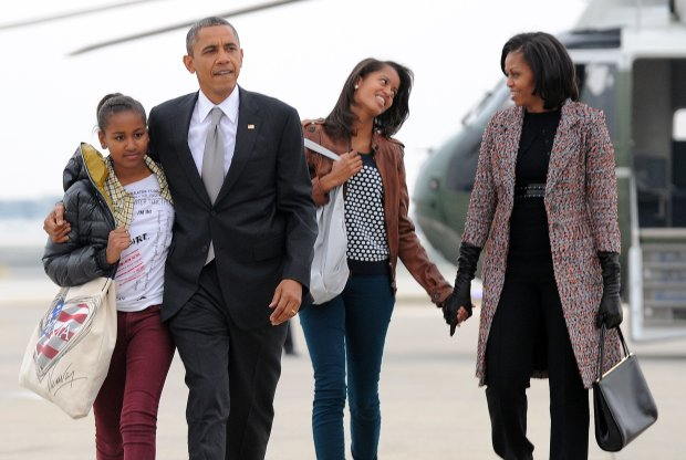 "US President Barack Obama, First Lady Michelle Obama and their daughters Malia and Sasha borad Air Force One at Chicago O'Hare International Airport in Chicago on November 7, 2012. Obama returns to Washington on Wednesday emboldened by his re-election but facing the daunting task of breaking down partisan gridlock in a bitterly divided Congress. Obama told Americans ""the best is yet to come"" after defying dark economic omens to handily defeat Mitt Romney, but his in-tray is already overflowing with unfulfilled first term wishes thwarted by blanket Republican opposition. AFP PHOTO/Jewel SamadAttn Editors : These file pictures are part of a ""Best of"" serie of the US President Barack Obama two terms in office. / AFP PHOTO / JEWEL SAMADJEWEL SAMAD/AFP/Getty Images"