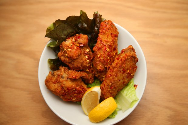 Tebakara is photographed at Yuzu Ramen & Broffee on Thursday, Jan. 5, 2016, in Emeryville, Calif. The dish consists of fried chicken wings that are coated in a Japanese chili pepper, and sesame seeds. (Aric Crabb/Bay Area News Group)