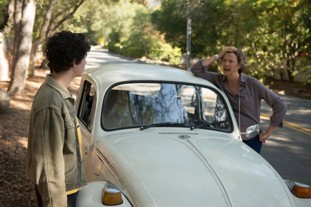 """This image released by A24 shows Annette Bening, right, and Lucas Zade Zumann in """"20th Century Women."""" (Merrick Morton/A24 via AP)"""