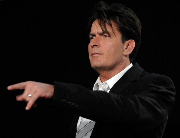 ** FILE ** In this Sunday, Aug. 17, 2008 picture, Charlie Sheen poses backstage at the 2008 ALMA Awards in Pasadena, Calif. Sheen's spokesman says the actor's two young daughters are doing fine after a Mercedes-Benz sports utility vehicle they were riding in collided with a sedan on Pacific Coast Highway on Friday, Dec. 12, 2008, sparking a multi-vehicle crash that sent one person to the hospital. (AP Photo/Chris Pizzello)