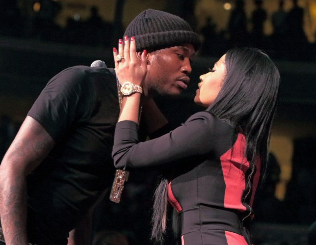 FILE - In this Oct. 23, 2015, file photo, Meek Mill and Nicki Minaj kiss after their performance at the Power 99 POWERHOUSE 2015 at the Wells Fargo Center in Philadelphia. Minaj announced on Twitter Jan. 5, 2017, that she is single. (Photo by Owen Sweeney/Invision/AP, File)