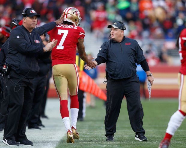 San Francisco 49ers head coach Chip Kelly high-fives San Francisco 49ers starting quarterback Colin Kaepernick (7) after the 49ers scored a touchdown against the Seattle Seahawks in the second quarter of their NFL game at Levi's Stadium in Santa Clara, Calif., on Sunday, Jan. 1, 2017. (Nhat V. Meyer/Bay Area News Group)