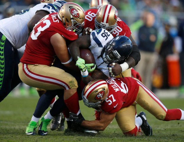 Seattle Seahawks' Alex Collins (36) is tackled by San Francisco 49ers' Chris Jones (93), San Francisco 49ers' Glenn Dorsey (90) and San Francisco 49ers' Michael Wilhoite (57) in the fourth quarter of their NFL game at Levi's Stadium in Santa Clara, Calif., on Sunday, Jan. 1, 2017. (Nhat V. Meyer/Bay Area News Group)