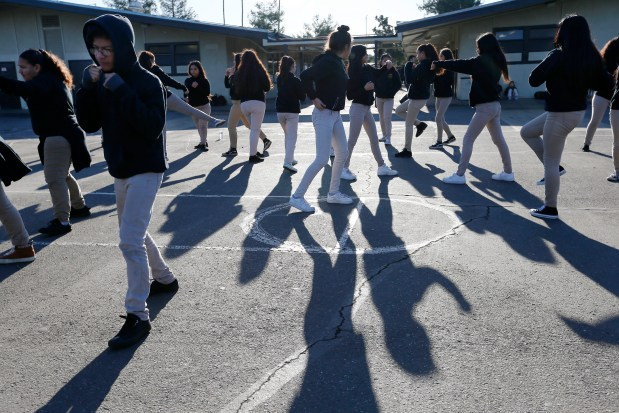 Students begin the morning shadow boxing during Personalized Leadership Training at the Alpha Jose Hernandez Middle School in San Jose, Calif., on Wednesday, Jan. 25, 2017. Students in the program learn to get themselves into shape physically and emotionally through physical exercise and classroom work. (Gary Reyes/Bay Area News Group)