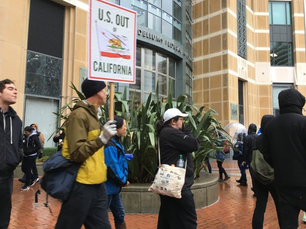 As Donald Trump prepares to be inaugurated, protestors march in front of the Ronald V. Dellums Federal Building in Oakland, Calif., on Friday, January 20, 2017 (Laura Oda/Bay Area News Group)