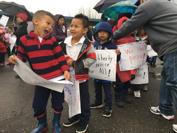 Students at Bridges Academy prepare to march as Donald Trump is inaugurated, in Oakland, Calif., on Friday, January 20, 2017 (Laura Oda/Bay Area News Group)