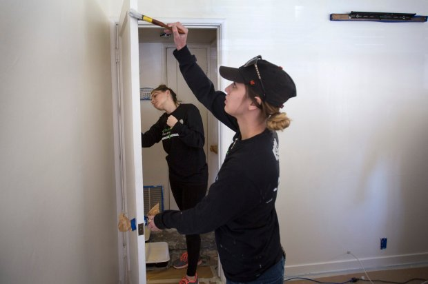 Volunteers Amber Cottle, left, and Sierra Burt do interior painting as Rebuilding Together Silicon Valley and the Sharks Foundation work on the home of Isiah Breaux, 93, and his 95 year old wife in San Jose, Calif., Friday, Jan. 13, 2017. They have been living in their home since 1950. Breaux was a Marine, worked in the SJ Canneries, and was a welder for GE. He is in good health, and cares for his wife who has health issues. (Patrick Tehan/Bay Area News Group)